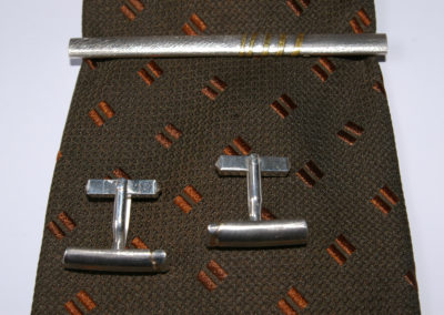 Manschettenknöpfe und Krawattenschmuck