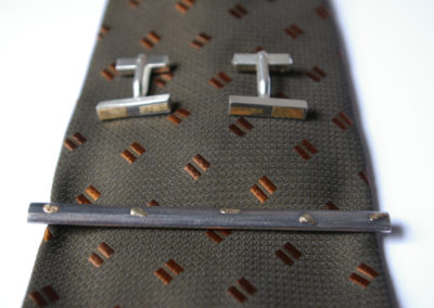 Krawattenschmuck und Manschettenknöpfe